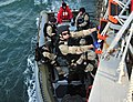 US Navy 120113-N-OP638-033 Sailors board a boat during a training exercise.jpg