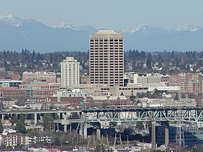 The U-District, looking northeast from Queen Anne. UW Tower is the tall building in the center, with the Hotel Deca (originally the Meany Hotel) to its left. The I-5 Ship Canal Bridge is in the foreground.