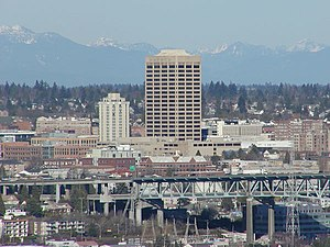 University District, Seattle - The U-District, looking northeast from Queen Anne. UW Tower is the tall building in the center, with the Hotel Deca (originally the Meany Hotel) to its left. The I-5 Ship Canal Bridge is in the foreground.