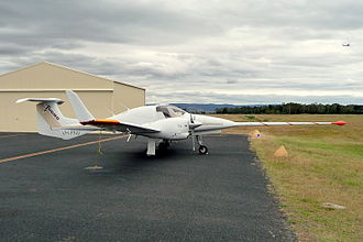 Magnetometer - A Diamond DA42 light aircraft, modified for aerial survey with a nose-mounted boom containing a magnetometer at its tip