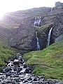 Valley waterfall at Hengifoss (14602751560).jpg