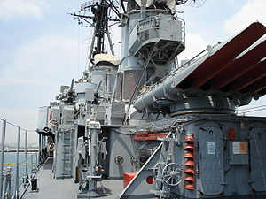 USS Charrette - Velos on 20 May 2006. Amidships view to bow and bridge. The 533 mm (21in) torpedo tubes and 76 mm (3in) AA guns can be seen. Note the Rank Flag flown at the foremast displacing downward the Commissioning pennant revealing that the ship is regarded as in commission