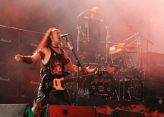 Venom's early work is considered a major influence on thrash metal. Venom live at hellfest.jpg