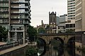 View to Blackfriars Bridge and Manchester Cathedral from Trinity Bridge.jpg