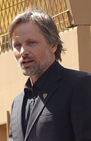 Viggo Mortensen speaking at a ceremony for Den...