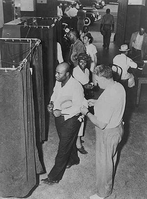 Voter suppression - Voters at voting booths in the United States in 1945