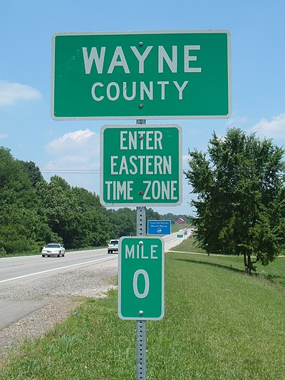 Marker showing the border of Wayne County, Kentucky, and the eastern time zone Wayne Co KY.JPG