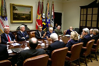 New START - Obama administration officials discussing the New START Treaty at a meeting.