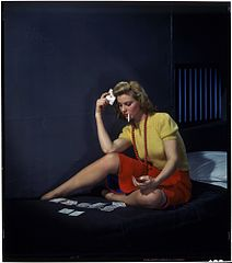 Woman in cell, playing solitaire.jpg