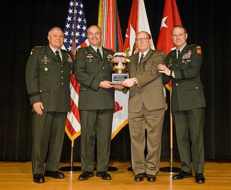 Yongsan Garrison - Army Vice Chief of Staff Gen. Richard A. Cody (left) and Installation Management Command Deputy Commander Maj. Gen. John A. Macdonald (right) present USAG-Yongsan officials with a third-place trophy for the Fiscal 2008 Army Communities of Excellence competition 8 May at the Pentagon.