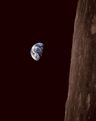 """""""We set out to explore the moon and instead discovered the Earth"""" (50412324277).png"""