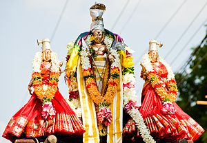 Devasena - Lord Murugan with Deivaanai (on right of image) and Valli (on left of image).