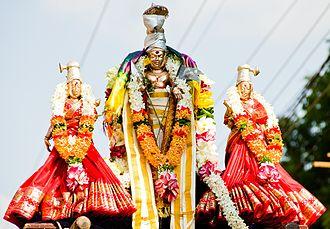 Valli - Lord Murugan with Deivaanai (on right of image) and Valli (on left of image).