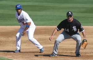 Rafael Furcal - Furcal (left) with White Sox first baseman Paul Konerko during spring training action, 2008.