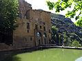 083 Sant Miquel del Fai, estany artificial i façana oest de la casa del priorat.JPG