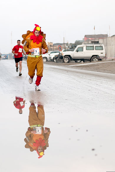U.S. Army serviceman in a turkey costume leads the Kabul Satellite Turkey Chase 10K Run on Thanksgiving Day, 2011 111127-A-HN782-207.jpg