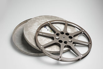 16mm empty film reel with its metal container 16mm film reel (6498649123).jpg