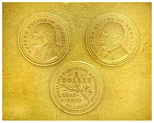 Louisiana Purchase Exposition dollar - Die impressions in cardboard of pattern versions of the gold dollars.  The reverse shows the olive branch larger than on the issued coins.