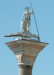 A statue of Saint Theodore of Amasea treading on a crocodile (Venice, Italy)