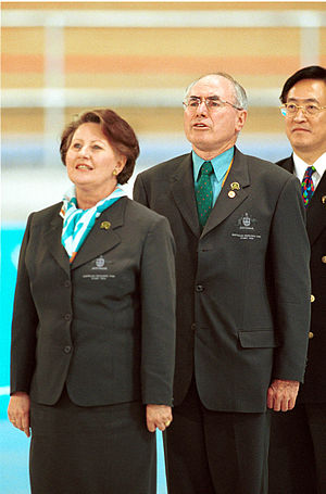 Janette Howard - Janette Howard with her husband John Howard in the Australian Team uniform during the 2000 Sydney Paralympic Games. The Howards attended several days of competition during the Games.