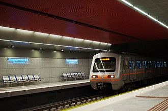 Line 3 (Athens Metro) - A Line 3 train approaching the northbound platform of the Nomismatokopio station