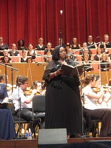African American singer performing with orchestral accompaniment