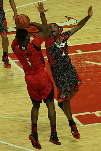 Aaron Harrison - Harrison defending against Wayne Selden in the 2013 McDonald's All-American Boys Game
