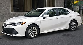 2019 Toyota Camry LE in white, front left.jpg
