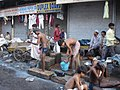 2384- Indians washing themselves in the street (57703183).jpg