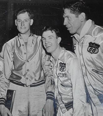 "Jimmy McNatt - AAU All-Americans Robert ""Ace"" Gruenig (left), Jimmy ""Scat"" McNatt (center) and Gordon ""Shorty"" Carpenter (right)."