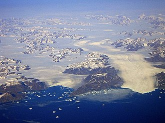 King Christian IX Land - View of the two K.J.V. Steenstrup Glaciers reaching the ocean south of Ikertivaq Fjord.