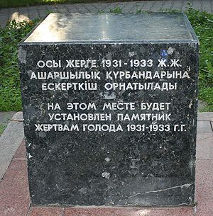 "Soviet famine of 1932–33 - The Russian part of the inscription says ""At this place will be a monument to famine victims of the years 1931-1933"". In the center of Almaty, Kazakhstan. The upper half is in Kazakh language."
