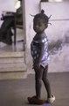 ASC Leiden - F. van der Kraaij Collection - 02 - 071 - A Ugandese girl wearing decorated wooden shoes - Old Road, Monrovia, Montserrado County, Liberia, 1975.tiff