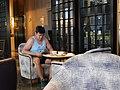 A Man is enjoying a coffee in the coffee shop.jpg