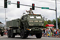 A U.S. Soldier with 17th Fires Brigade, on a high mobility artillery rocket system truck, waves to people during the Independence Day parade at Tumwater, Wash., July 4, 2013 130704-A-AU369-491.jpg