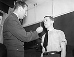 A medical officer conducts an eye test during medical examinations of aircrew candidates in London, May 1940. CH120.jpg