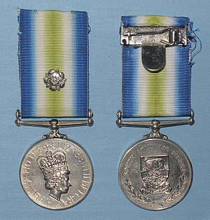 South Atlantic Medal - A pair of South Atlantic Medals. The one on the left shows the front of the medal and the rosette can be seen