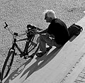 A tourist and a bicycle in Lisbon (29703062513).jpg
