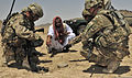 Abdul Manaf, center, the Takhteh Pol district chief of police, and U.S. Army Lt. Col. Carlos Schroder, second from right, with Security Forces Assistance Team 15, discuss possible locations for an Afghan Uniform 120809-A-DL064-065.jpg