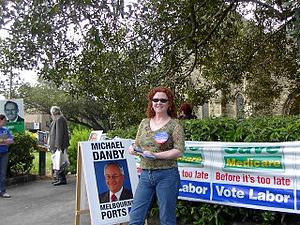 A party worker for the Australian Labor Party hands out How-to-Vote Cards at a polling place in St Kilda, Victoria, in the Division of Melbourne Ports, on election day, 9 October 2004.