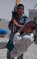 Afghan police build swing set for boys school 120517-M-DM345-022.jpg