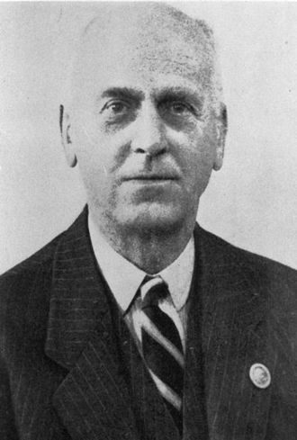 Edward Masterman - Air Commodore Edward Masterman, pictured wearing an early Observer Corps lapel badge on his suit jacket.