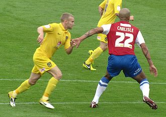 Clarke Carlisle - Carlisle (right) playing for York City in 2012