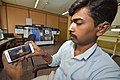 An Office Employee Observes Live Chandrayaan 2 Launching on His Mobile - Kolkata 2019-07-22 0520.JPG