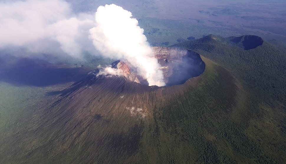 An aerial view of the towering volcanic peak of Mt. Nyiragongo