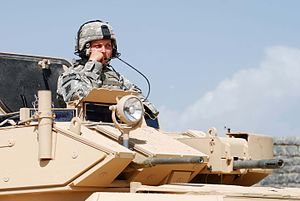 M1117 Armored Security Vehicle - The turret has a .50 caliber M2HB machine gun (left) and Mk 19 grenade launcher (right)