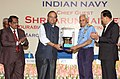 Arun Jaitley handing over a replica of RLG based inertial navigation system for ship applications (INS-SA) to the Chief of Naval Staff, Admiral Sunil Lanba.jpg