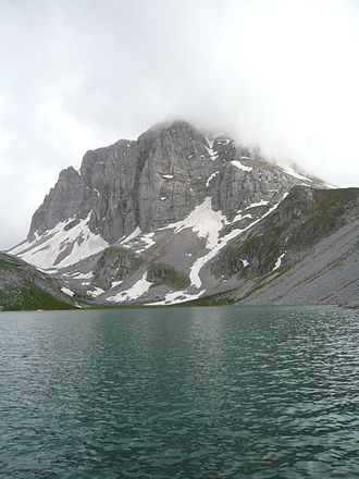 Tymfi - The north face of Astraka photographed in May. The field of Astraka has thirty climbing routes. Note that the lake in the foreground is seasonal
