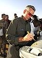 Auburn University head coach Tommy Tuberville signs a munition on the flightline in Southwest Asia.jpg