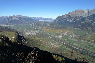 Alpine Rhine river and its valley landscape in the Alps, in Switzerland, Austria and Lichtenstein